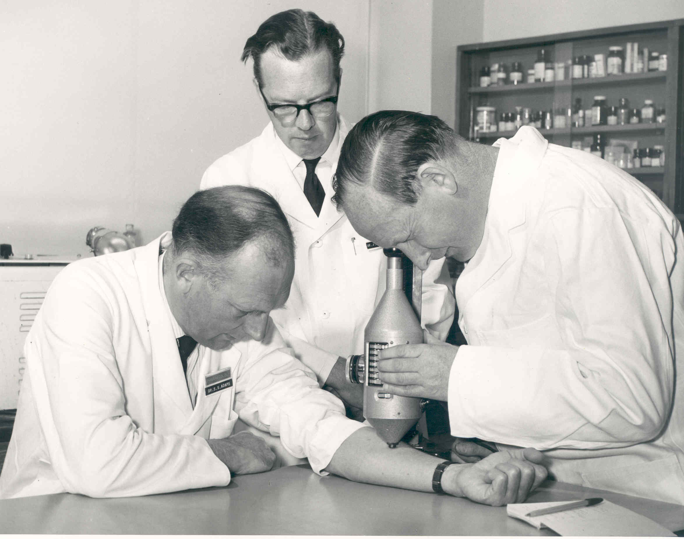 Dr Stewart Adams, Dr John Nicholson and Mr R Cobb studying degrees of inflammation using a colour intensity measuring device.